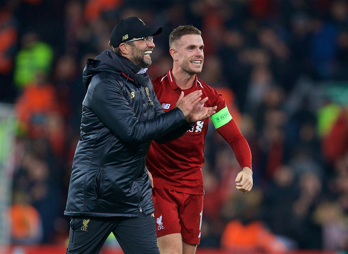 LIVERPOOL, ENGLAND - Tuesday, December 11, 2018: Liverpool's manager Jürgen Klopp celebrates with captain Jordan Henderson after beating SSC Napoli 1-0 and progressing to the knock-out phase during the UEFA Champions League Group C match between Liverpool FC and SSC Napoli at Anfield. (Pic by David Rawcliffe/Propaganda)