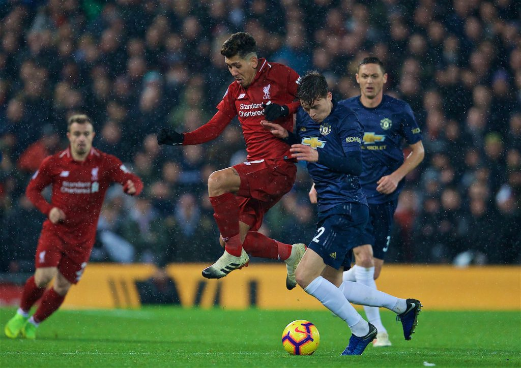 LIVERPOOL, ENGLAND - Sunday, December 16, 2018: Liverpool's Roberto Firmino and Manchester United's Victor Lindelöf during the FA Premier League match between Liverpool FC and Manchester United FC at Anfield. (Pic by David Rawcliffe/Propaganda)