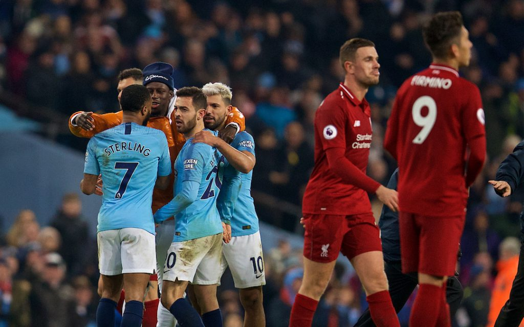 MANCHESTER, ENGLAND - Thursday, January 3, 2019: Manchester City's Manchester City's Benjamin Mendy (orange coat) celebrates the 2-1 victory over Liverpool at the final whistle with team-mates Raheem Sterling and Bernardo Silva after the FA Premier League match between Manchester City FC and Liverpool FC at the Etihad Stadium. (Pic by David Rawcliffe/Propaganda)
