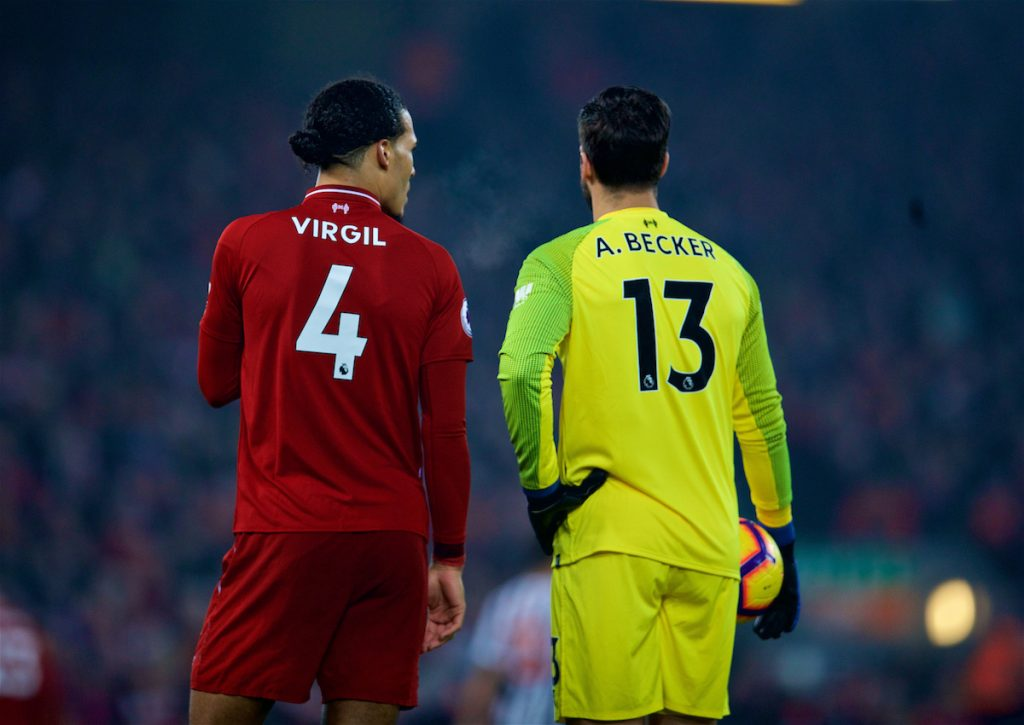 LIVERPOOL, ENGLAND - Boxing Day, Wednesday, December 26, 2018: Liverpool's Virgil van Dijk (L) and goalkeeper Alisson Becker during the FA Premier League match between Liverpool FC and Newcastle United FC at Anfield. (Pic by David Rawcliffe/Propaganda)