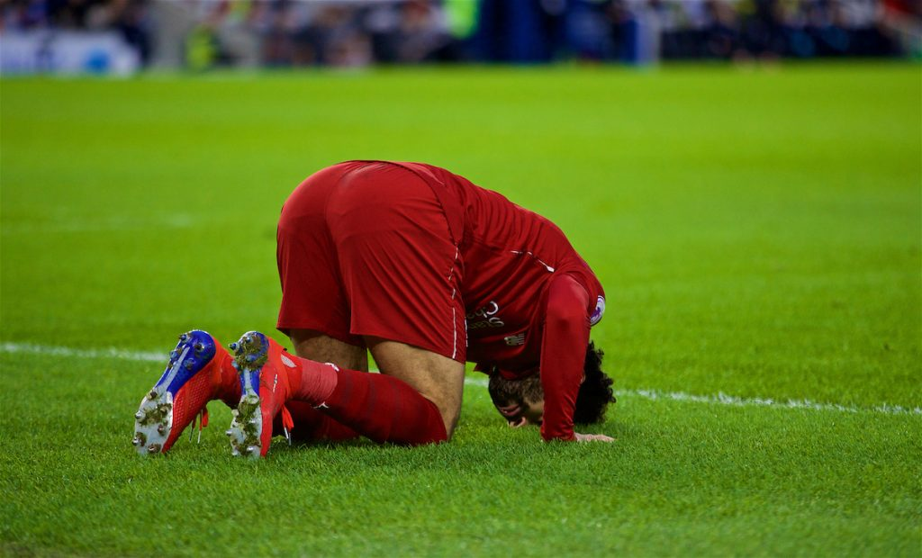 BRIGHTON AND HOVE, ENGLAND - Saturday, January 12, 2019: Liverpool's Mohamed Salah kneels to pray as he celebrates scoring the first goal during the FA Premier League match between Brighton & Hove Albion FC and Liverpool FC at the American Express Community Stadium. (Pic by David Rawcliffe/Propaganda)