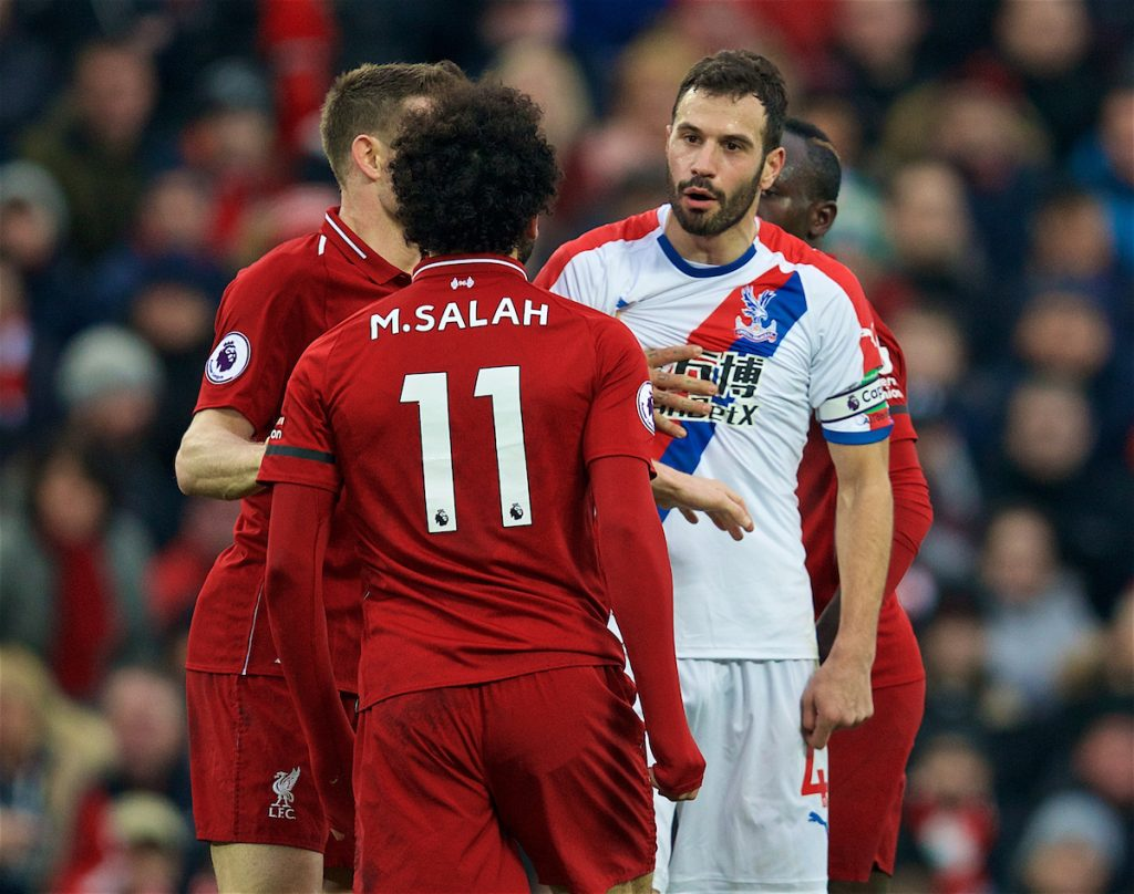 LIVERPOOL, ENGLAND - Saturday, January 19, 2019: Crystal Palace's captain Luka Milivojevi? clashes with Liverpool's Mohamed Salah during the FA Premier League match between Liverpool FC and Crystal Palace FC at Anfield. (Pic by David Rawcliffe/Propaganda)