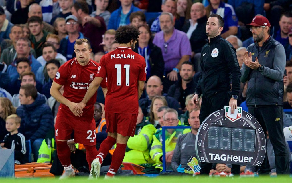LONDON, ENGLAND - Saturday, September 29, 2018: Liverpool's Mohamed Salah is replaced by substitute Xherdan Shaqiri by manager J¸rgen Klopp during the FA Premier League match between Chelsea FC and Liverpool FC at Stamford Bridge. (Pic by David Rawcliffe/Propaganda)