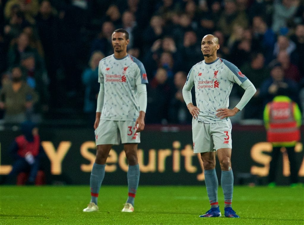 LONDON, ENGLAND - Monday, February 4, 2019: Liverpool's Joel Matip and Fabio Henrique Tavares 'Fabinho' look dejected as West Ham United score an equalising goal during the FA Premier League match between West Ham United FC and Liverpool FC at the London Stadium. (Pic by David Rawcliffe/Propaganda)