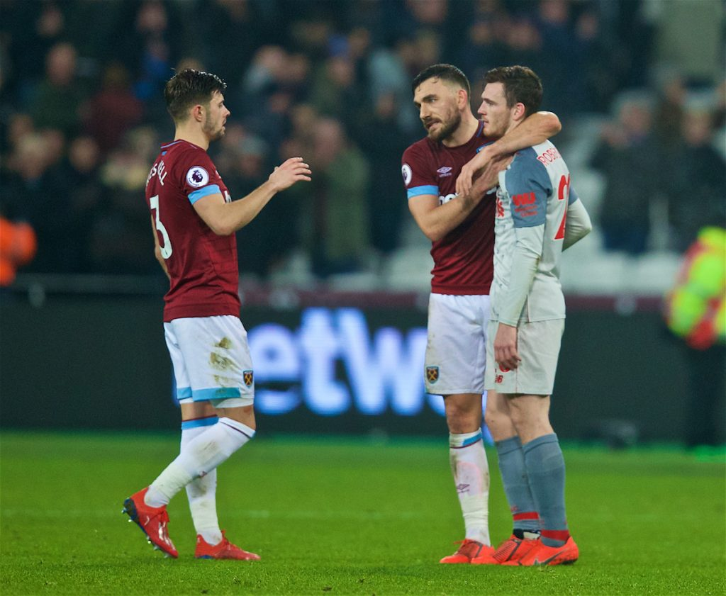 LONDON, ENGLAND - Monday, February 4, 2019: Liverpool's Andy Robertson with West Ham United's Robert Snodgrass and Aaron Cresswell at the final whistle during the FA Premier League match between West Ham United FC and Liverpool FC at the London Stadium. (Pic by David Rawcliffe/Propaganda)