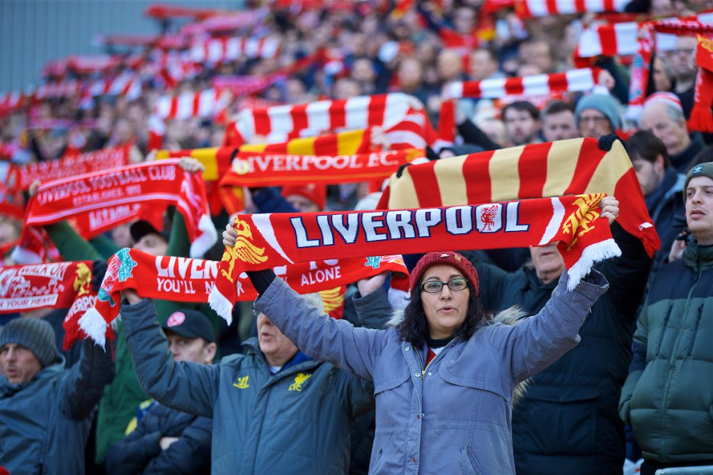 "LIVERPOOL, ENGLAND - Saturday, February 9, 2019: A Liverpool supporters hold up a scarves and sing ""You'll Never Walk Alone"" before the FA Premier League match between Liverpool FC and AFC Bournemouth at Anfield. (Pic by David Rawcliffe/Propaganda)"