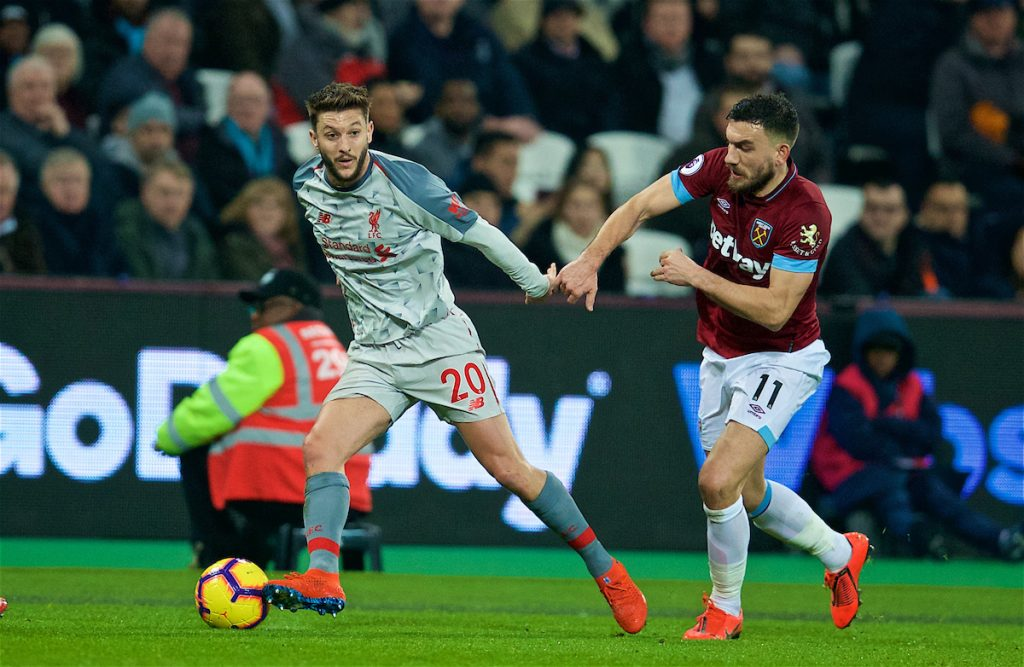 LONDON, ENGLAND - Monday, February 4, 2019: Liverpool's Adam Lallana and West Ham United's Robert Snodgrass during the FA Premier League match between West Ham United FC and Liverpool FC at the London Stadium. (Pic by David Rawcliffe/Propaganda)