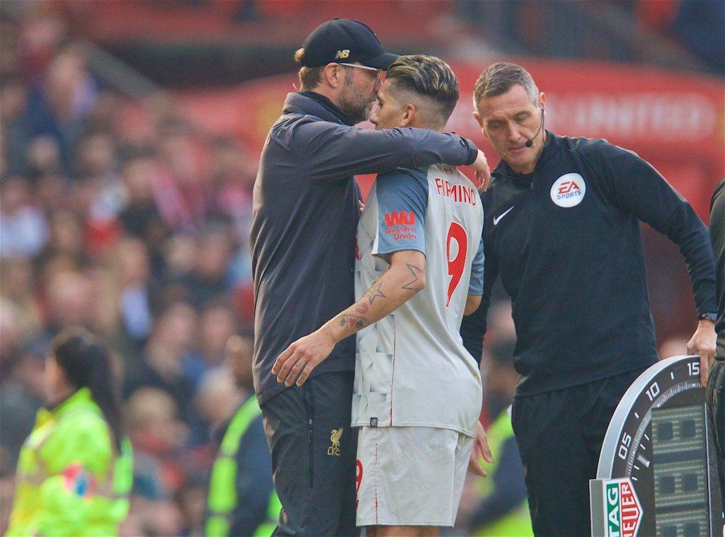 MANCHESTER, ENGLAND - Sunday, February 24, 2019: Liverpool's Roberto Firmino embraces manager Jürgen Klopp after being injured during the FA Premier League match between Manchester United FC and Liverpool FC at Old Trafford. (Pic by David Rawcliffe/Propaganda)