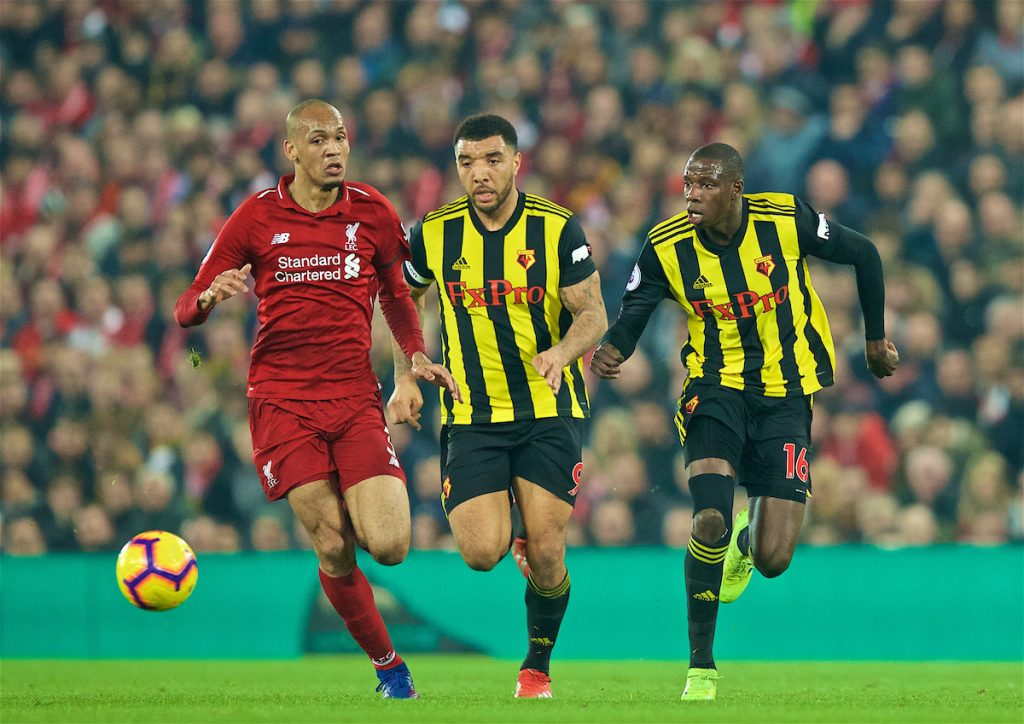 LIVERPOOL, ENGLAND - Wednesday, February 27, 2019: Liverpool's Fabio Henrique Tavares 'Fabinho' is chased down by Watford's captain Troy Deeney (C) and Abdoulaye Doucouré (R) during the FA Premier League match between Liverpool FC and Watford FC at Anfield. (Pic by Paul Greenwood/Propaganda)