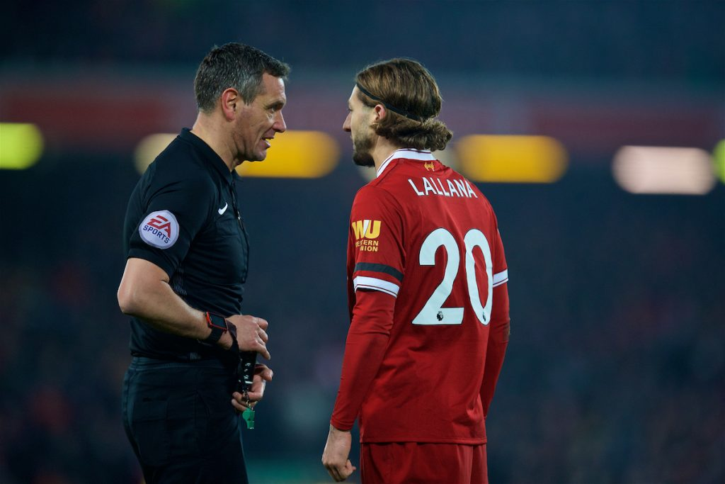 LIVERPOOL, ENGLAND - Sunday, January 14, 2018: Liverpool's Adam Lallana speaks to referee Andre Marriner during the FA Premier League match between Liverpool and Manchester City at Anfield. (Pic by David Rawcliffe/Propaganda)