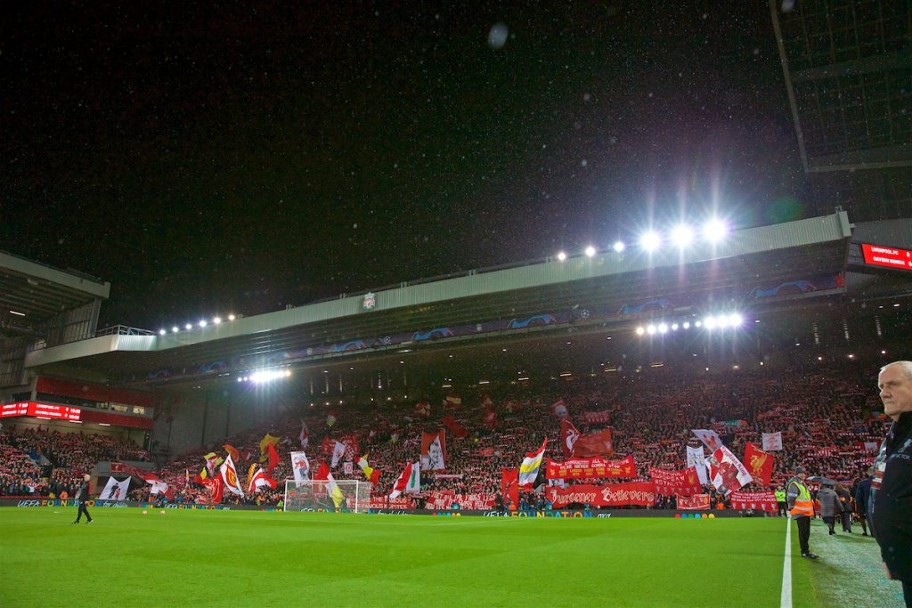 """LIVERPOOL, ENGLAND - Tuesday, February 19, 2019: Liverpool supporters on the Spion Kop sing """"You'll Never Walk Alone"""" before the UEFA Champions League Round of 16 1st Leg match between Liverpool FC and FC Bayern München at Anfield. (Pic by David Rawcliffe/Propaganda)"""