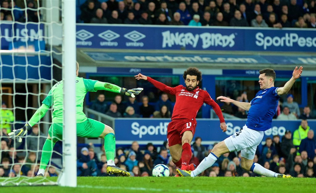 LIVERPOOL, ENGLAND - Sunday, March 3, 2019: Liverpool's Mohamed Salah is denied by Everton's Michael Keane during the FA Premier League match between Everton FC and Liverpool FC, the 233rd Merseyside Derby, at Goodison Park. (Pic by Paul Greenwood/Propaganda)