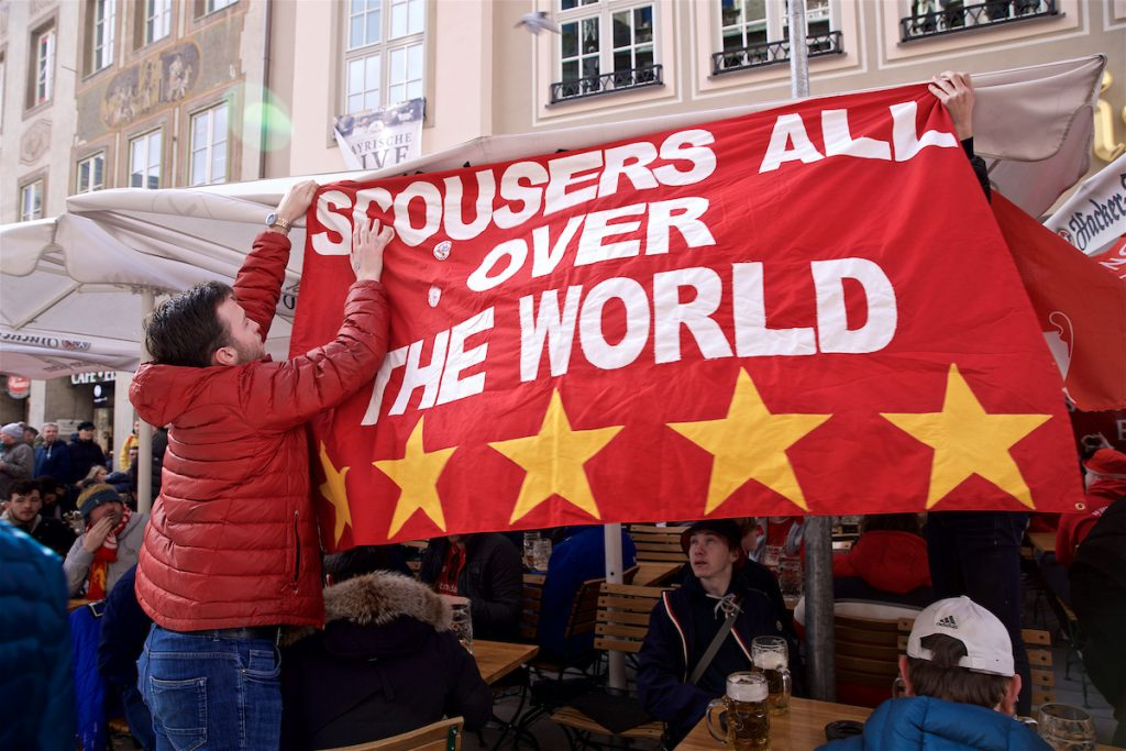 """MUNICH, GERMANY - Wednesday, March 13, 2019: Liverpool supporters put up a banner """"Scousers all over the World"""" in a bar in Weinstrasse near Munich's Marienplatz ahead of the UEFA Champions League Round of 16 2nd Leg match between FC Bayern München and Liverpool FC. (Pic by David Rawcliffe/Propaganda)"""