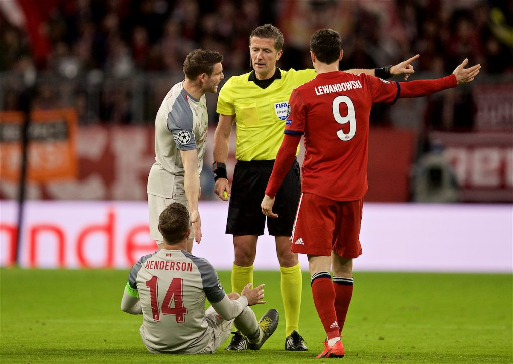 MUNICH, GERMANY - Wednesday, March 13, 2019: Liverpool's captain Jordan Henderson goes down injured as the referee Daniele Orsato orders him off the field during the UEFA Champions League Round of 16 2nd Leg match between FC Bayern München and Liverpool FC at the Allianz Arena. (Pic by David Rawcliffe/Propaganda)