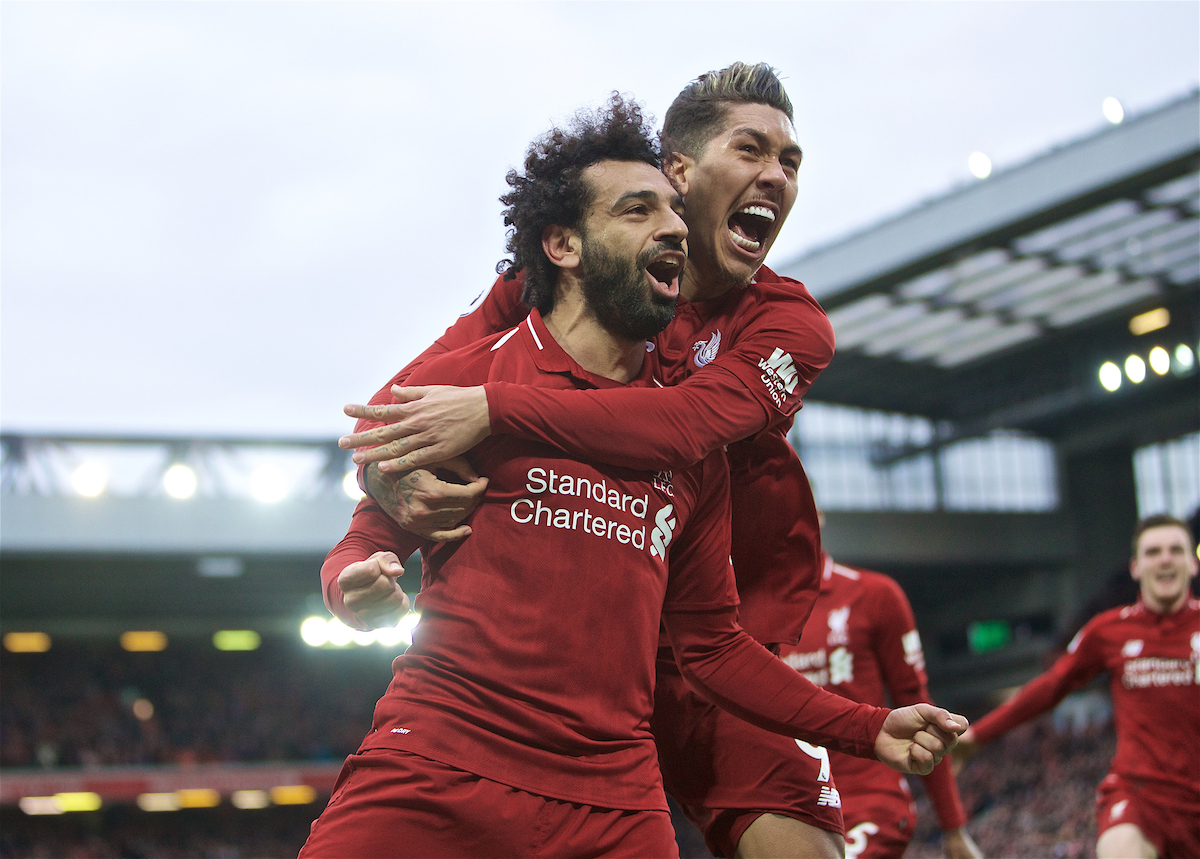 LIVERPOOL, ENGLAND - Sunday, March 31, 2019: Liverpool's Mohamed Salah celebrates after his header forced a winning goal, an own goal from Tottenham Hotspur's Toby Alderweireld with team mate Roberto Firmino during the FA Premier League match between Liverpool FC and Tottenham Hotspur FC at Anfield. (Pic by David Rawcliffe/Propaganda)