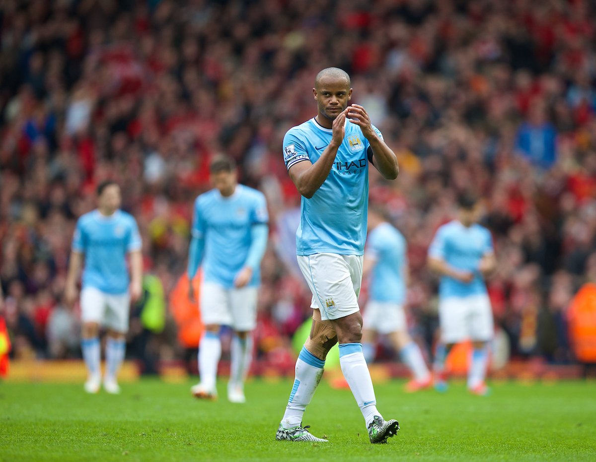 LIVERPOOL, ENGLAND - Sunday, April 13, 2014: Manchester City's Vincent Kompany looks dejected as his side lose 3-2 to Liverpool during the Premiership match at Anfield. (Pic by David Rawcliffe/Propaganda)