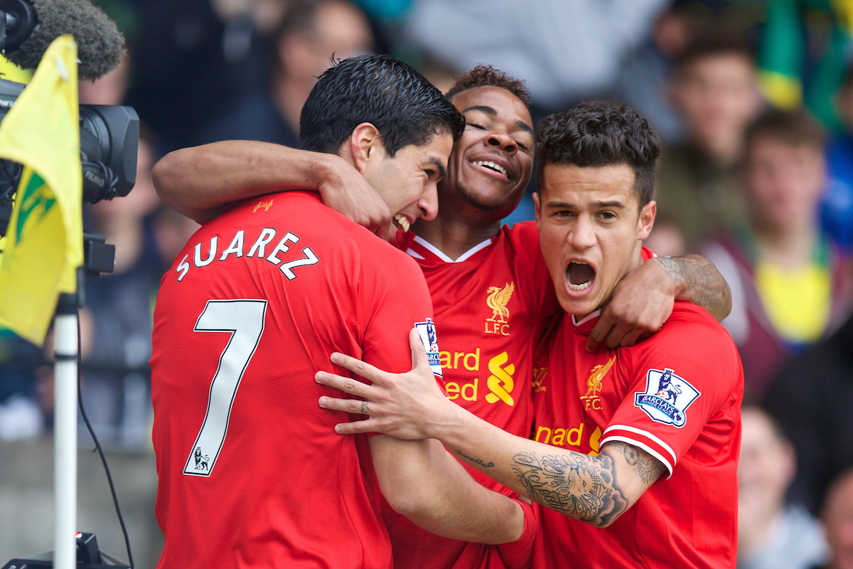 NORWICH, ENGLAND - Sunday, April 20, 2014: Liverpool's Luis Suarez celebrates scoring the second goal against Norwich City with team-mates Raheem Sterling and Philippe Coutinho Correia during the Premiership match at Carrow Road. (Pic by David Rawcliffe/Propaganda)