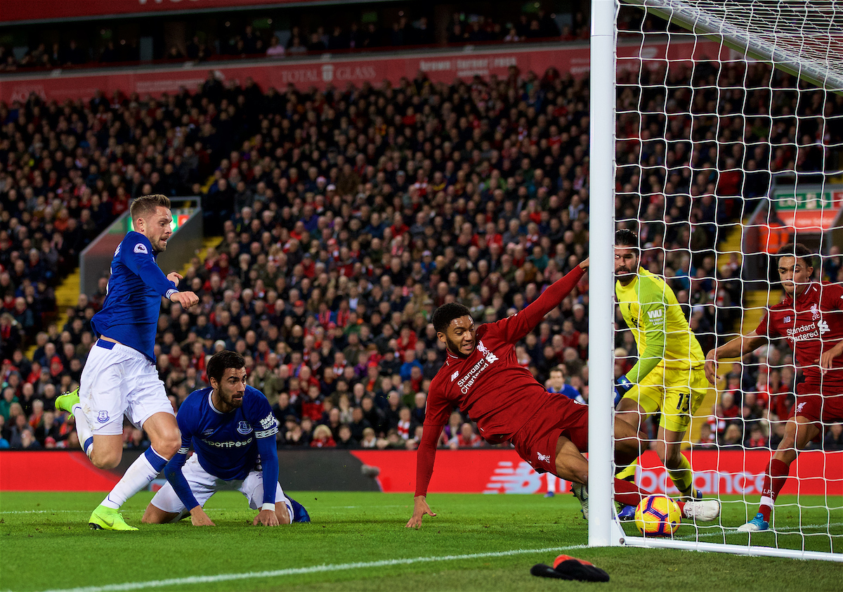 LIVERPOOL, ENGLAND - Sunday, December 2, 2018: Liverpool's Joe Gomez clears the ball off the line as Everton's Andre Gomes and captain Gylfi Sigurdsson look on during the FA Premier League match between Liverpool FC and Everton FC at Anfield, the 232nd Merseyside Derby. (Pic by Paul Greenwood/Propaganda)