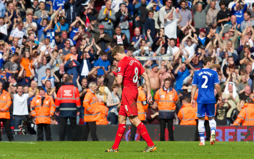 Sunday, April 27, 2014: Liverpool's captain Steven Gerrard looks dejected at the final whistle as Chelsea's ultra defensive play leads to a 2-0 victory during the Premiership match at Anfield.