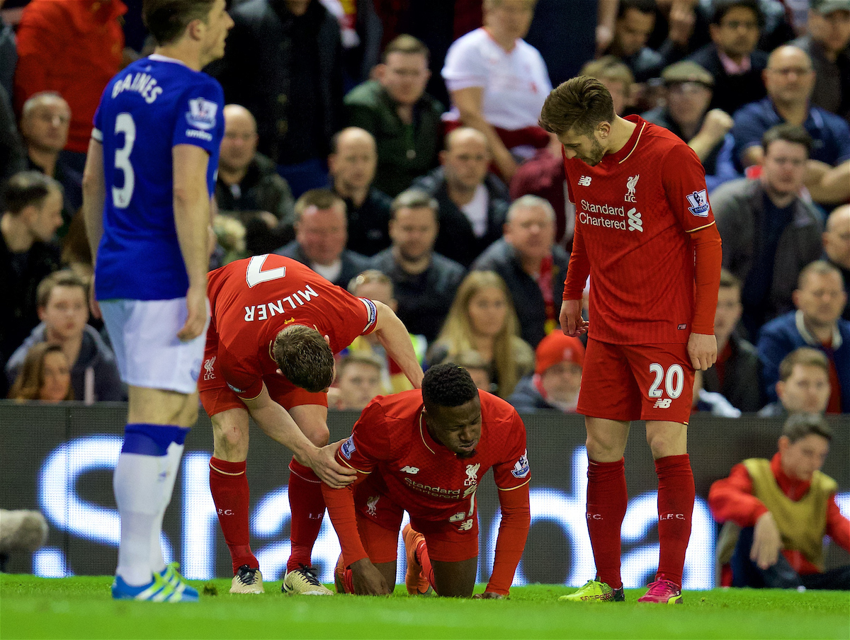 LIVERPOOL, ENGLAND - Wednesday, April 20, 2016: Liverpool's Divock Origi lies injured during the Premier League match against Everton at Anfield, the 226th Merseyside Derby. (Pic by David Rawcliffe/Propaganda)