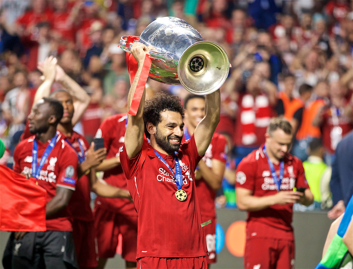 MADRID, SPAIN - SATURDAY, JUNE 1, 2019: Liverpool's goalscorer Mohamed Salah celebrates with the cup after the UEFA Champions League Final match between Tottenham Hotspur FC and Liverpool FC at the Estadio Metropolitano. Liverpool won 2-0 to win their sixth European Cup. (Pic by David Rawcliffe/Propaganda)