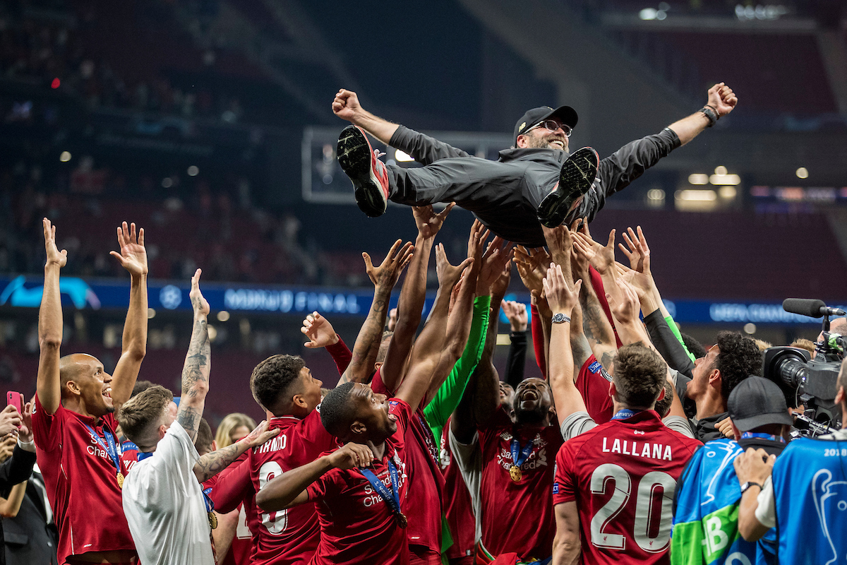 MADRID, SPAIN - SATURDAY, JUNE 1, 2019: Liverpool's players throw Liverpool Manager Jurgen Klopp in the air as they celebrate a 2-0 victory in the UEFA Champions League Final match between Tottenham Hotspur FC and Liverpool FC at the Estadio Metropolitano. (Pic by Paul Greenwood/Propaganda)
