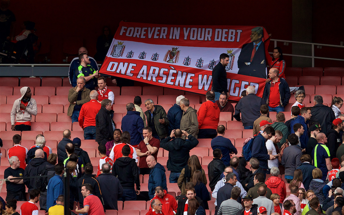 """LONDON, ENGLAND - Sunday, April 2, 2017: Arsenal's supporters hold aloft a banner supporting manager Arsene Wenger """"Forever In Your Debt One Arsene Wenger"""" after the 2-2 draw with Manchester City the FA Premier League match at the Emirates Stadium. (Pic by David Rawcliffe/Propaganda)"""