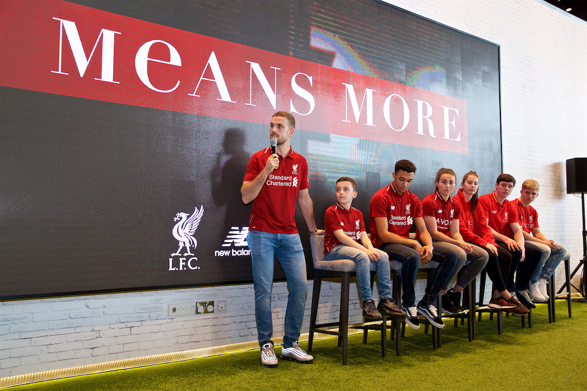 LIVERPOOL, ENGLAND - Tuesday, April 17, 2018: Liverpool captain Jordan Henderson with competition winner Spencer Davis, Trent Alexander-Arnold, Ladies players Amy Turner and  Ellie Fletcher, and Liverpool Under-18's players Liam Coyle and Edvard Tagseth during a press event to reveal the team's new kits for the 2018-19 season at the official club store at Anfield. (Pic by Jason Roberts/Propaganda)