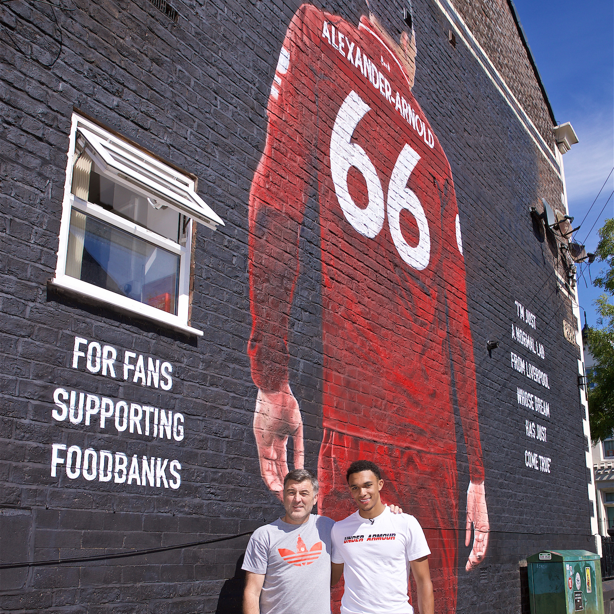 LIVERPOOL, ENGLAND - Thursday, August 8, 2019: Trent Alexander-Arnold poses for a photograph with Liverpool Foodbanks at the official opening of a mural of Liverpool's Trent Alexander-Arnold on the side of a building in Sybil Road, Anfield. The mural was commissioned by The Anfield Wrap and painted by local artist Akse P19. (Pic by David Rawcliffe/Propaganda)