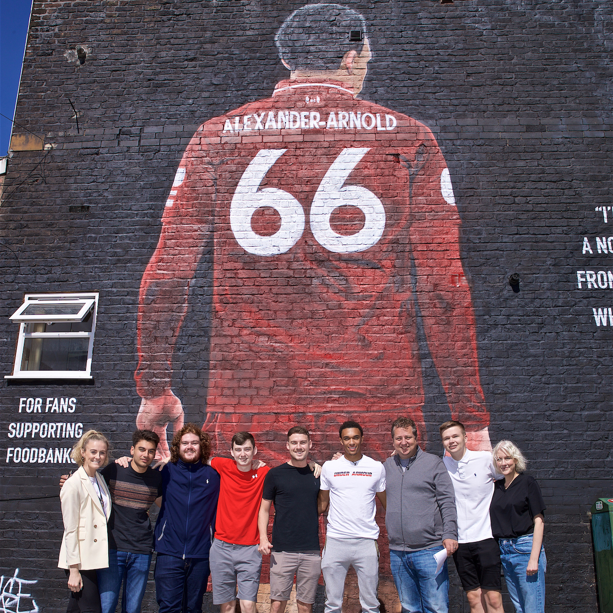 LIVERPOOL, ENGLAND - Thursday, August 8, 2019: The Anfield Wrap with Trent Alexander-Arnold at the official opening of a mural of Liverpool's Trent Alexander-Arnold on the side of a building in Sybil Road, Anfield. The mural was commissioned by The Anfield Wrap and painted by local artist Akse P19. (Pic by David Rawcliffe/Propaganda)