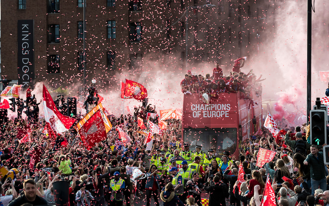 Liverpool's captain Jordan Henderson holds the Champions League Trophy during an open-top bus parade through the city after winning the UEFA Champions League Final. Liverpool beat Tottenham Hotspur. 2-0 in Madrid. To claim their sixth European Cup.