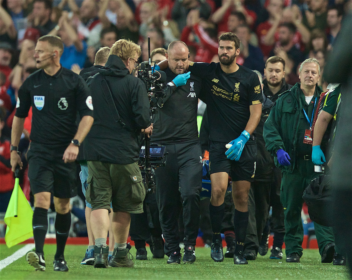 LIVERPOOL, ENGLAND - Friday, August 9, 2019: Liverpool's goalkeeper Alisson Becker goes off injured during the opening FA Premier League match of the season between Liverpool FC and Norwich City FC at Anfield. (Pic by David Rawcliffe/Propaganda)