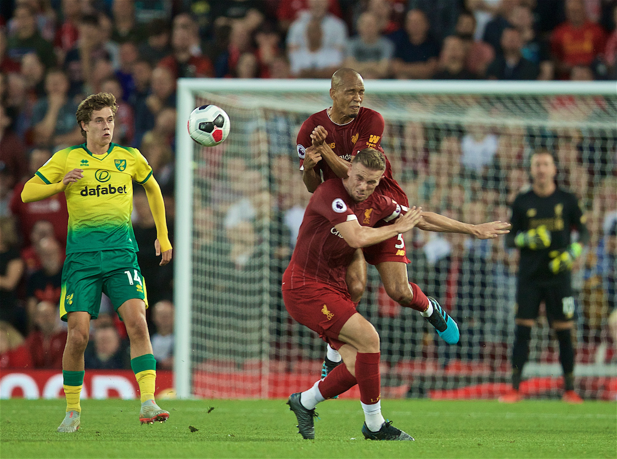 LIVERPOOL, ENGLAND - Friday, August 9, 2019: Liverpool's Fabio Henrique Tavares 'Fabinho' and captain Jordan Henderson clash during the opening FA Premier League match of the season between Liverpool FC and Norwich City FC at Anfield. (Pic by David Rawcliffe/Propaganda)
