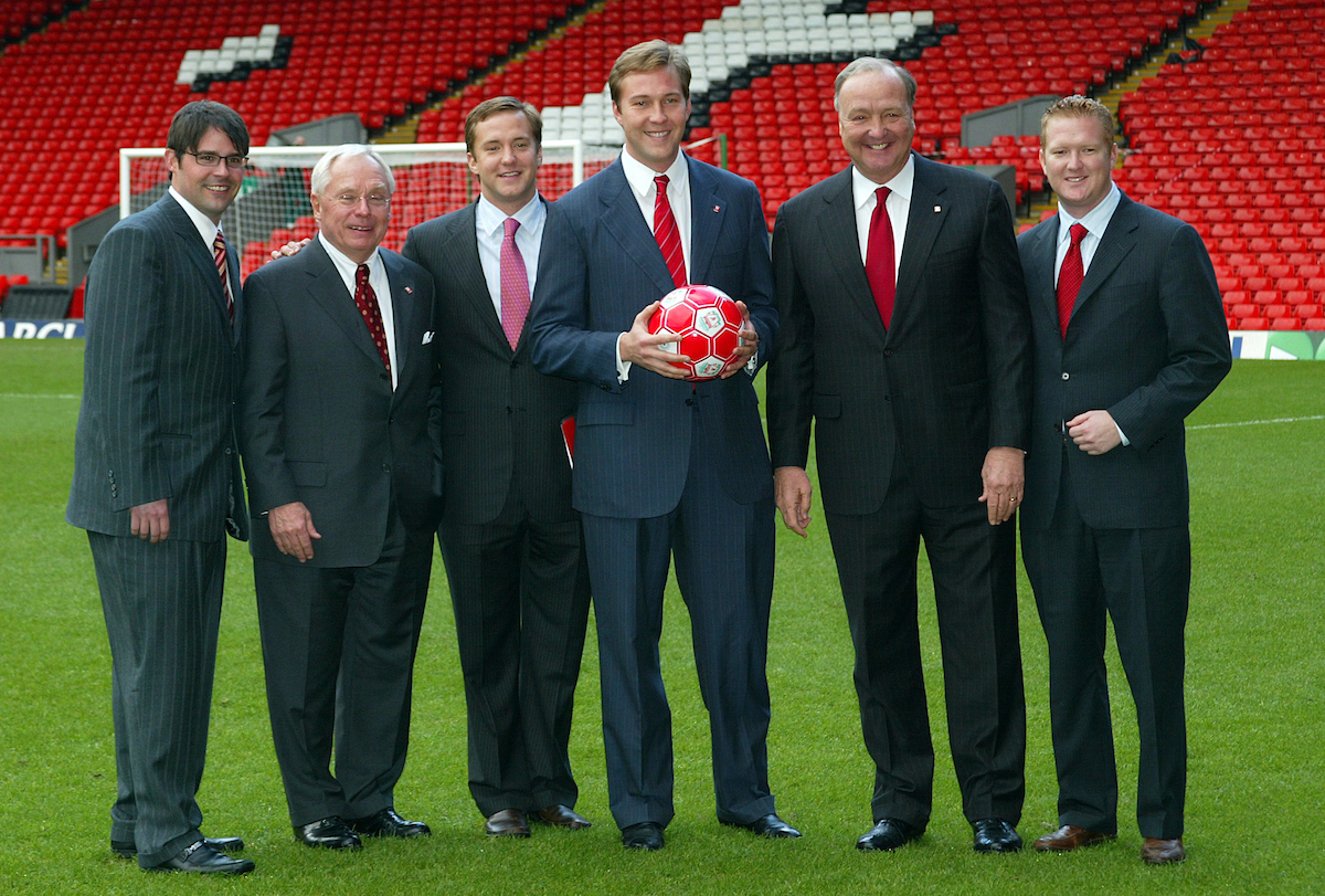 Tuesday, February 6th, 2007: George Gillett (2nd Left) with his sons Foster (L) and xxxx (R) and co-owner Tom Hicks (2nd from right) with his sons Tom Jnr (L) and Alex (R), on the pitch at Anfield after announcing their take-over of Liverpool Football Club in a deal worth around £470 million. Texan billionaire Hicks, who owns the Dallas Stars ice hockey team and the Texas Rangers baseball team, has teamed up with Montreal Canadiens owner Gillett to put together a joint £450m package to buy out shareholders, service the club's existing debt and provide funding for the planned new stadium in Stanley Park.