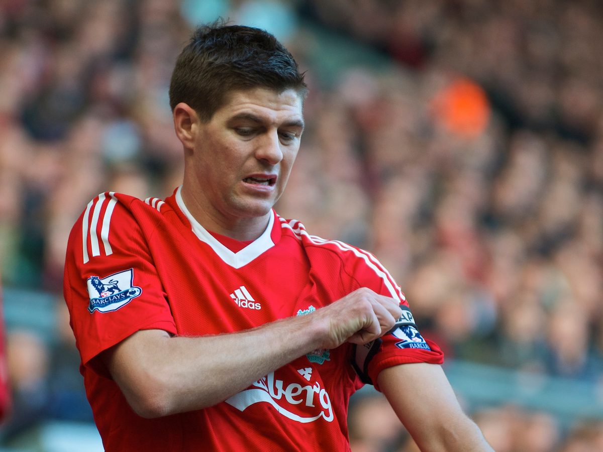LIVERPOOL, ENGLAND - Saturday, February 6, 2010: Liverpool's captain Steven Gerrard MBE adjusts his armband, the week he was made England vice-captain after John Terry was sacked as England captain after an adulteress affair with a team-mate's partner. (Photo by: David Rawcliffe/Propaganda)