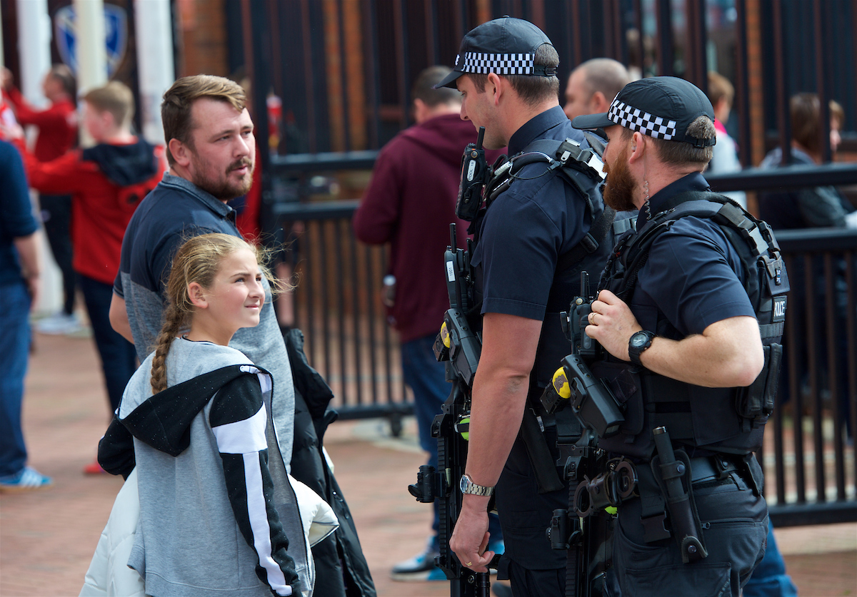 LIVERPOOL, ENGLAND - Saturday, September 16, 2017: Armed Merseyside Police officers patrol outside Anfield's Spion Kop stand before the FA Premier League match between Liverpool and Burnley at Anfield. (Pic by Peter Powell/Propaganda)
