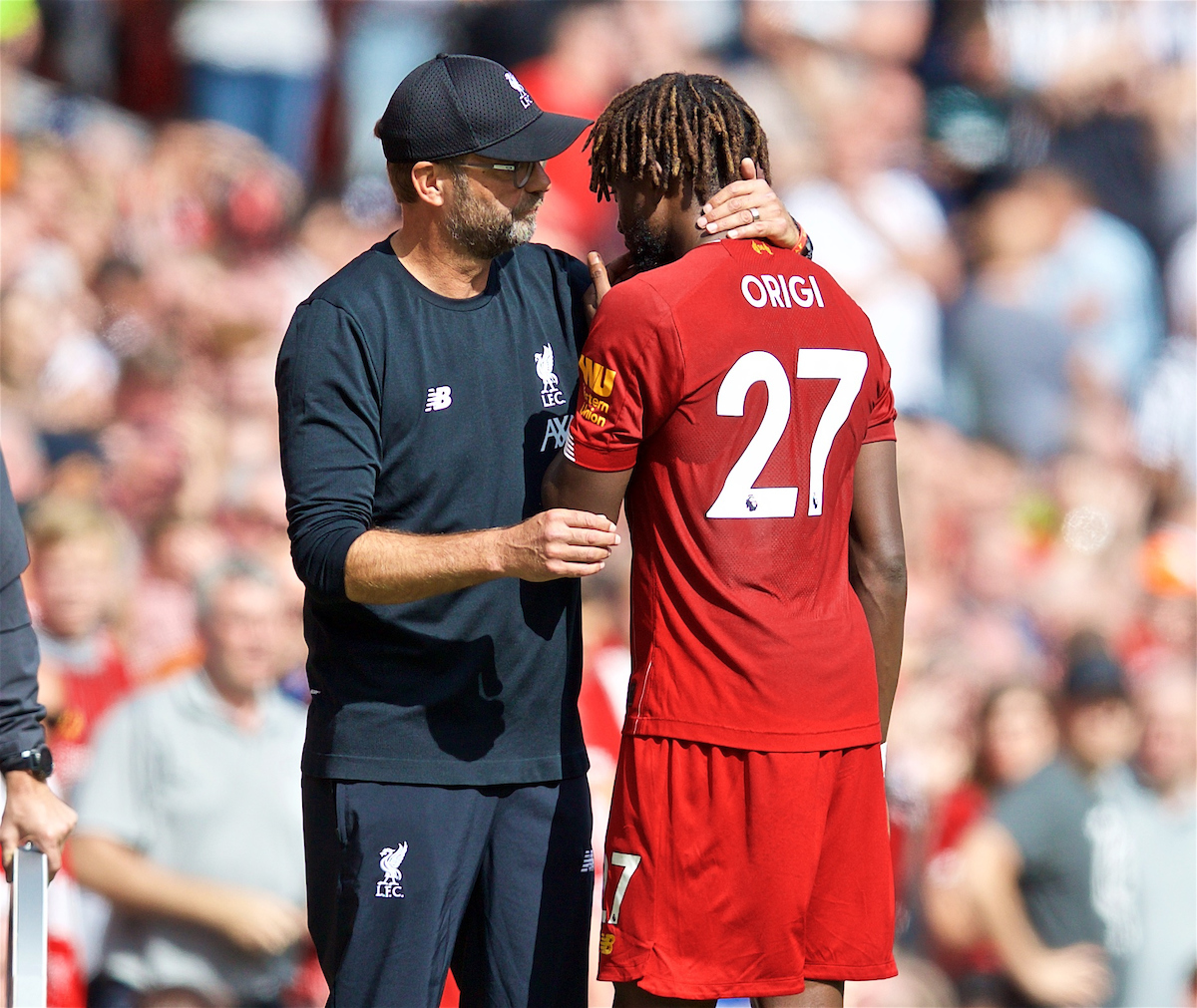 LIVERPOOL, ENGLAND - Saturday, September 14, 2019: Liverpool's manager Jürgen Klopp speaks with Divock Origi as he is substituted with an injury during the FA Premier League match between Liverpool FC and Newcastle United FC at Anfield. (Pic by David Rawcliffe/Propaganda)