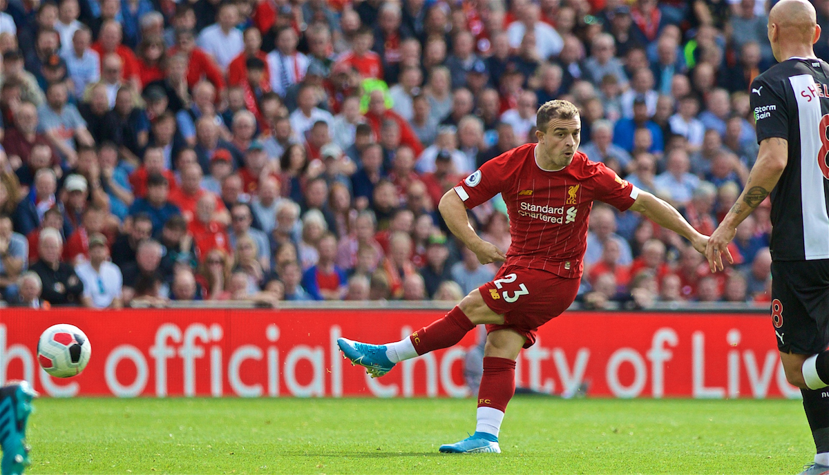 LIVERPOOL, ENGLAND - Saturday, September 14, 2019: Liverpool's substitute Xherdan Shaqiri makes a Roberto Firmino-esque 'no look' pass during the FA Premier League match between Liverpool FC and Newcastle United FC at Anfield. (Pic by David Rawcliffe/Propaganda)