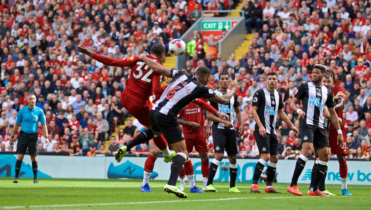 LIVERPOOL, ENGLAND - Saturday, September 14, 2019: Liverpool's Joel Matip is pulled back by Newcastle United's captain Jamaal Lascelles put no penalty is awarded during the FA Premier League match between Liverpool FC and Newcastle United FC at Anfield. (Pic by David Rawcliffe/Propaganda)