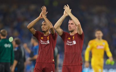 Liverpool's Fabio Henrique Tavares 'Fabinho' (L) and captain Jordan Henderson applaud the supporters after the UEFA Champions League Group E match between SSC Napoli and Liverpool FC at the Studio San Paolo