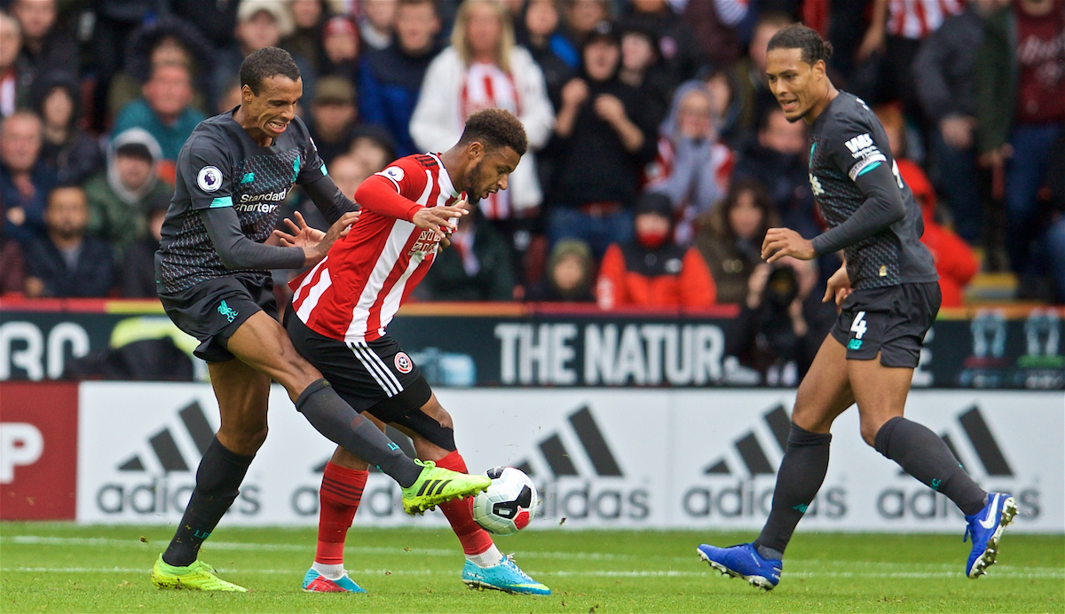 SHEFFIELD, ENGLAND - Thursday, September 26, 2019: Liverpool's Joel Matip (L) tackles Sheffield United's Lys Mousset during the FA Premier League match between Sheffield United FC and Liverpool FC at Bramall Lane. (Pic by David Rawcliffe/Propaganda)