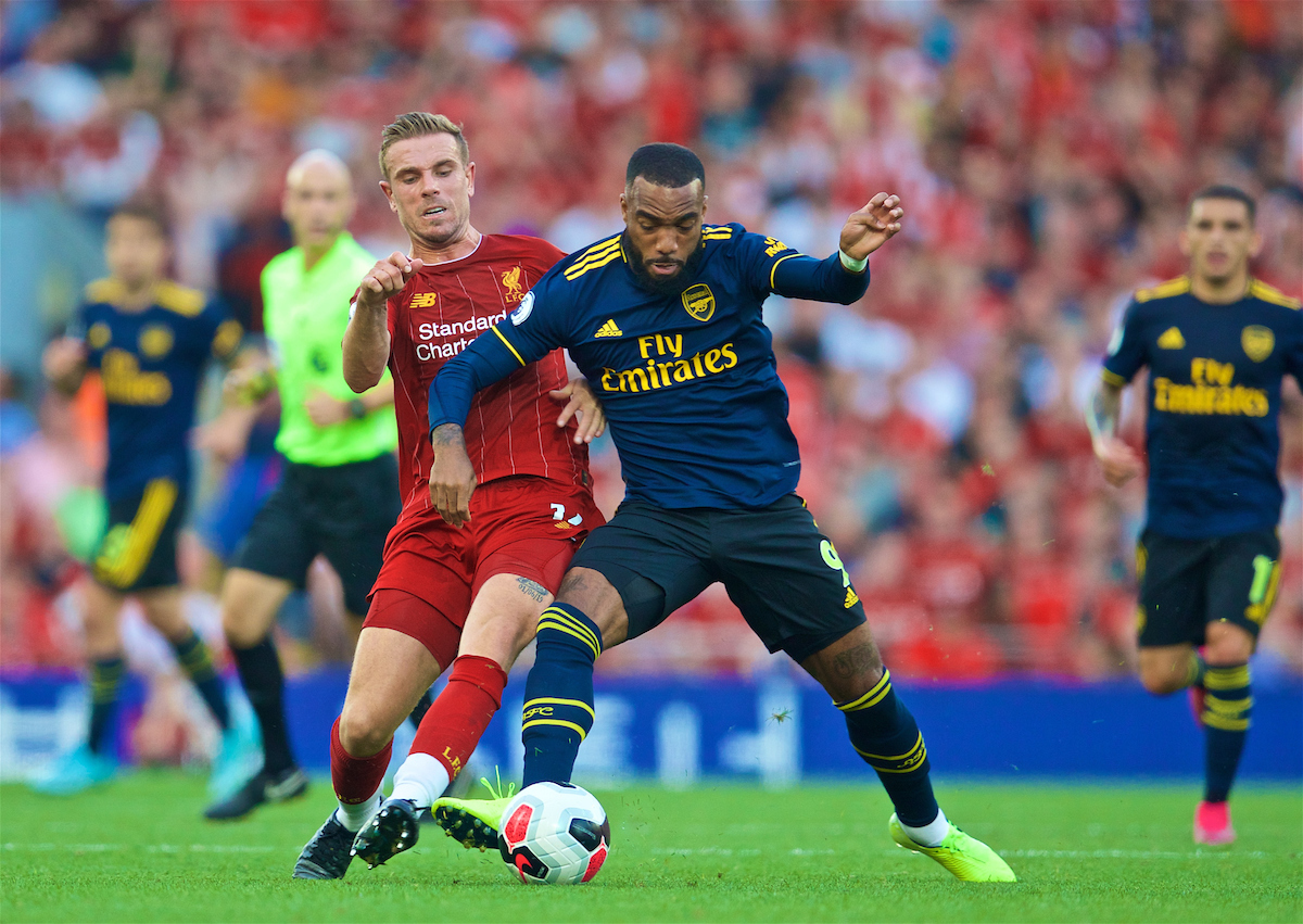 LIVERPOOL, ENGLAND - Saturday, August 24, 2019: Liverpool's captain Jordan Henderson (L) tackles Arsenal's Alexandre Lacazette during the FA Premier League match between Liverpool FC and Arsenal FC at Anfield. (Pic by David Rawcliffe/Propaganda)