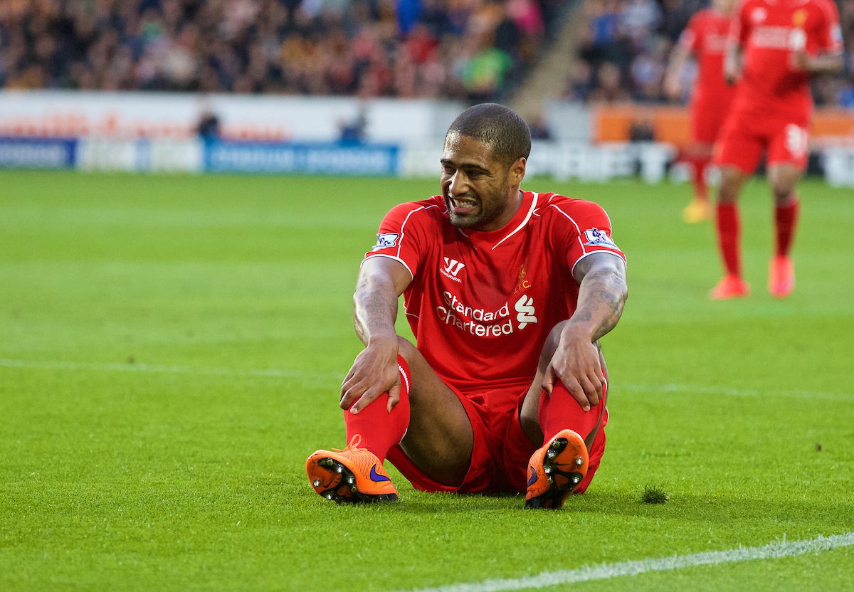 KINGSTON-UPON-HULL, ENGLAND - Tuesday, April 28, 2015: Liverpool's Glen Johnson feels the pain against Hull City during the Premier League match at the KC Stadium. (Pic by Gareth Jones/Propaganda)