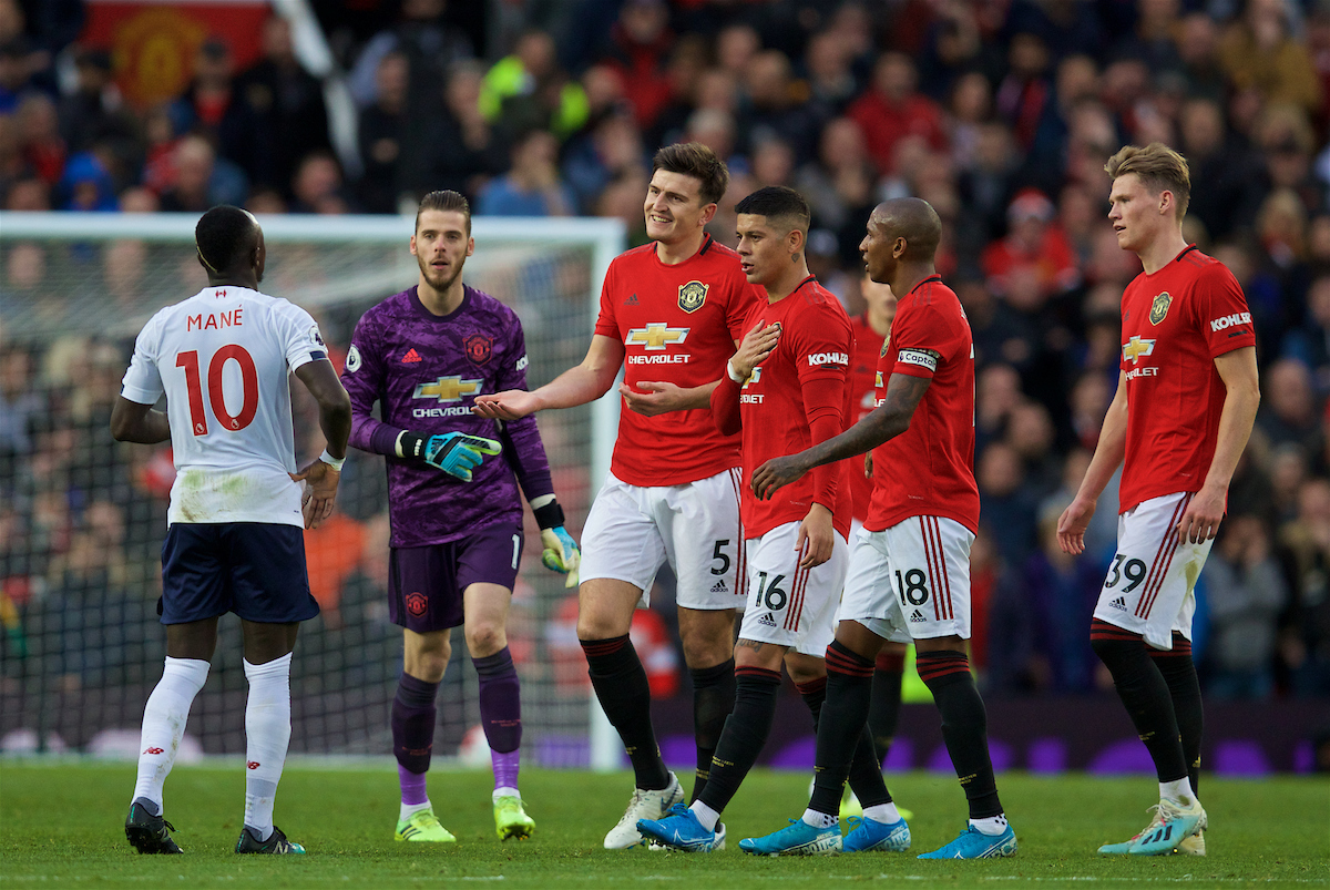 MANCHESTER, ENGLAND - Saturday, October 19, 2019: Manchester United players goalkeeper David de Gea, Harry Maguire, Marcos Rojo, Ashley Young and Scott McTominay rush to tell Liverpool's goalscorer Sadio Mane that his goal was disallowed by VAR during the FA Premier League match between Manchester United FC and Liverpool FC at Old Trafford. (Pic by David Rawcliffe/Propaganda)