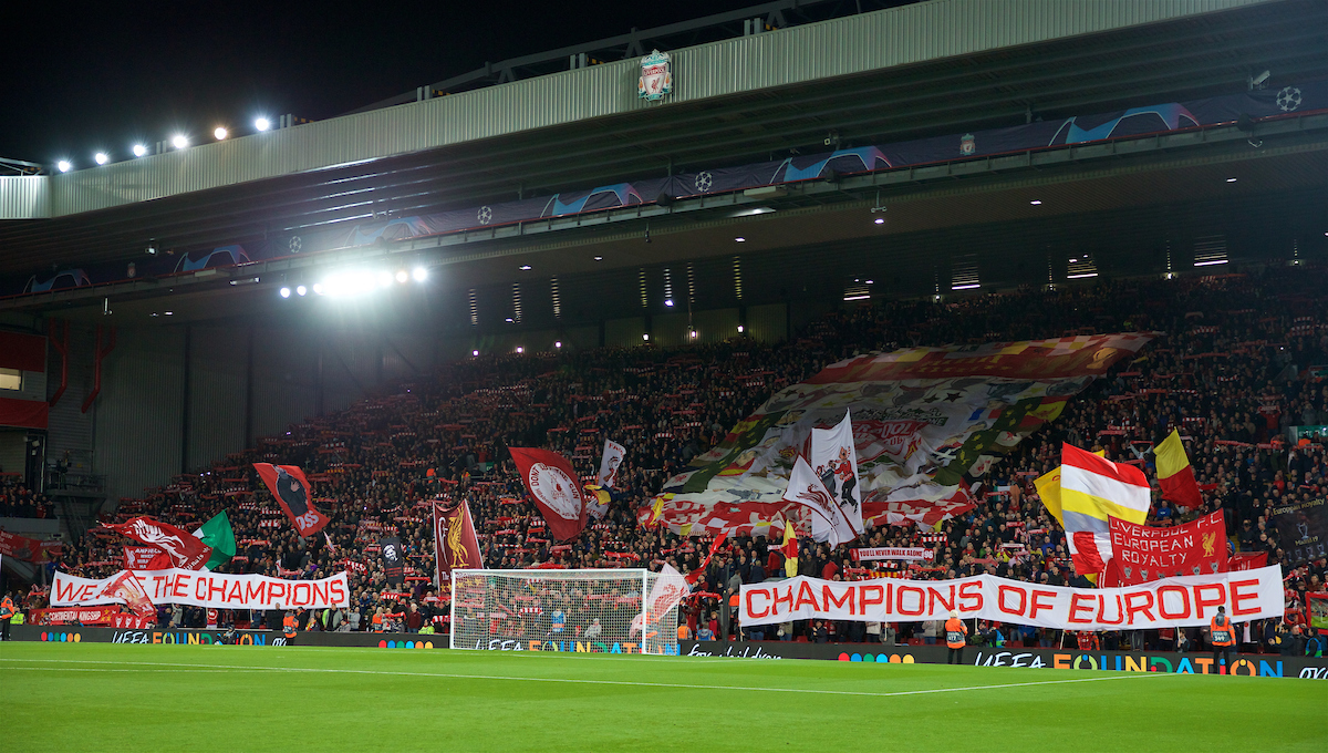 """LIVERPOOL, ENGLAND - Wednesday, October 2, 2019: Liverpool supporters on the Spion Kop with a banner """"We are the Champions, Champions of Europe"""" during the UEFA Champions League Group E match between Liverpool FC and FC Salzburg at Anfield. (Pic by David Rawcliffe/Propaganda)"""