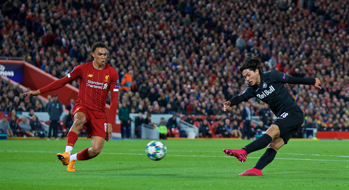 LIVERPOOL, ENGLAND - Wednesday, October 2, 2019: FC Salzburg's Takumi Minamino (R) shoots as Liverpool's Trent Alexander-Arnold looks on during the UEFA Champions League Group E match between Liverpool FC and FC Salzburg at Anfield. (Pic by David Rawcliffe/Propaganda)