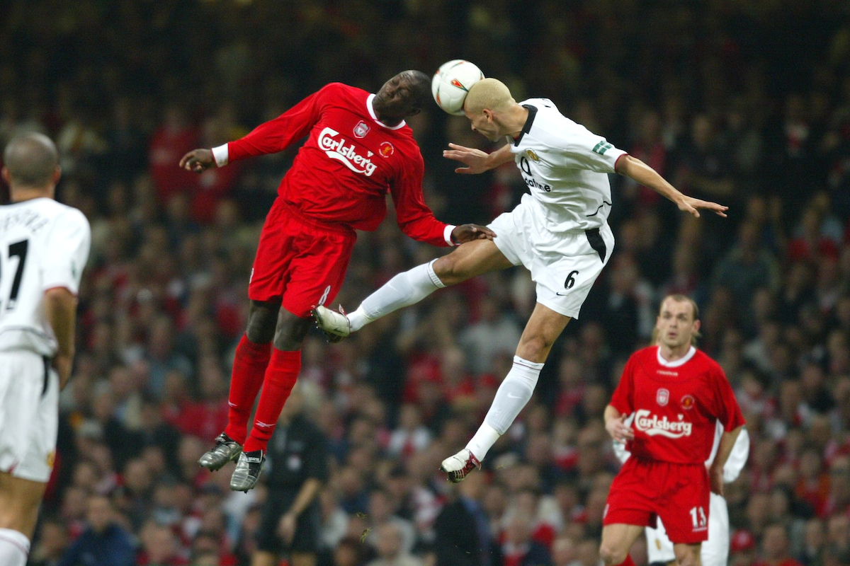 CARDIFF, WALES - Sunday, March 2, 2003: Liverpool's Emile Heskey and Manchester United's Wes Brown during the Football League Cup Final at the Millennium Stadium. (Pic by David Rawcliffe/Propaganda)