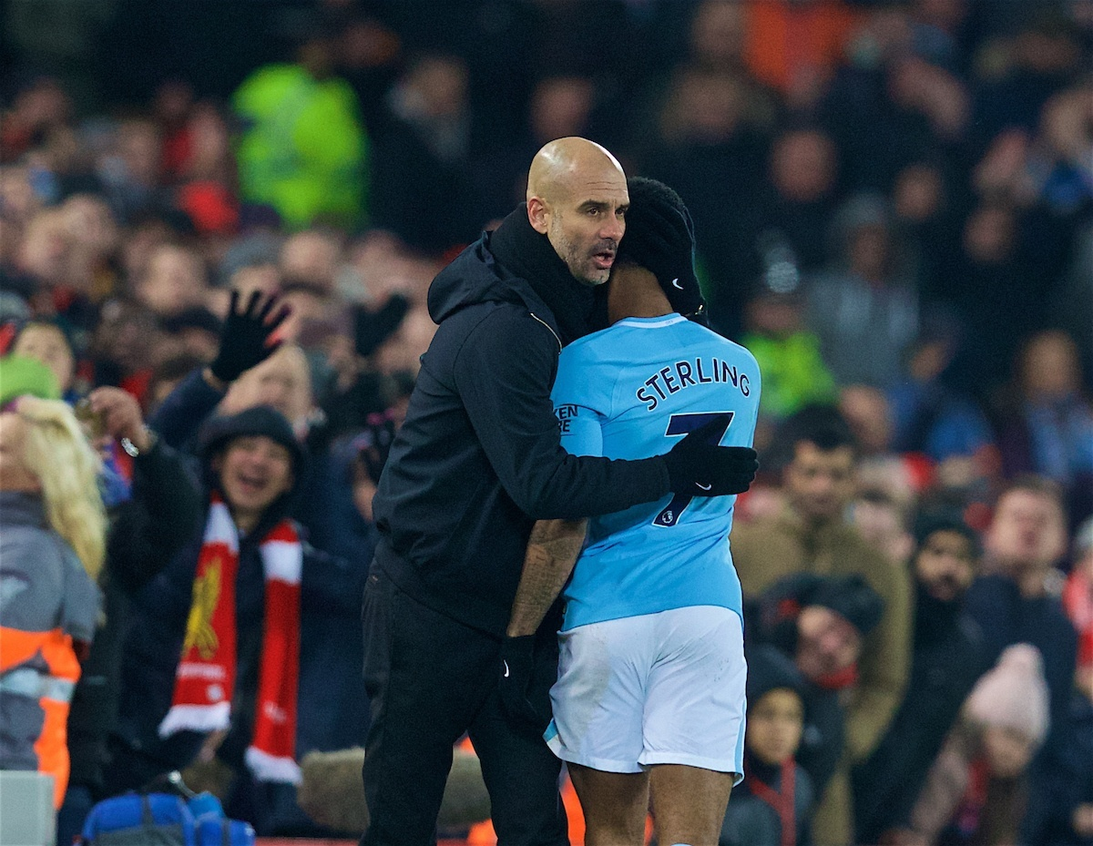 LIVERPOOL, ENGLAND - Sunday, January 14, 2018: Manchester City's Raheem Sterling is embraced by manager Pep Guardiola as he is substituted during the FA Premier League match between Liverpool and Manchester City at Anfield. (Pic by David Rawcliffe/Propaganda)