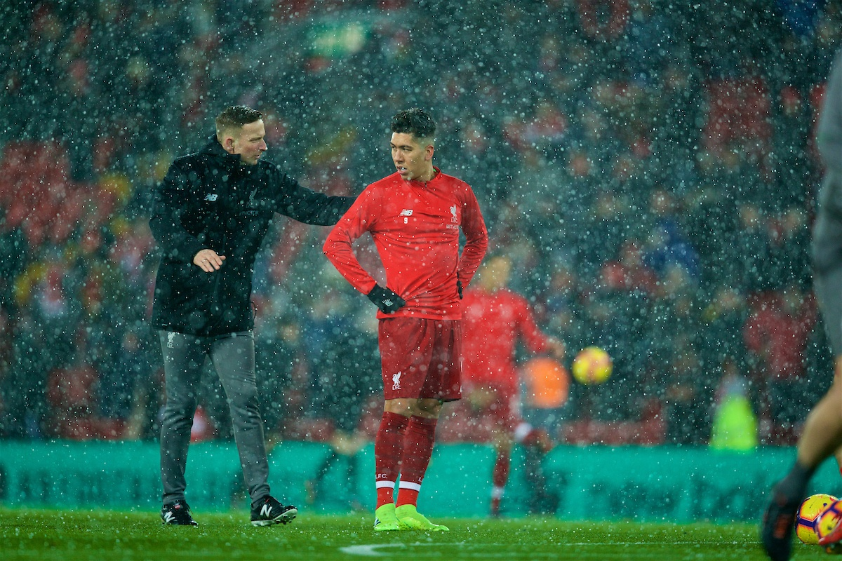 LIVERPOOL, ENGLAND - Wednesday, January 30, 2019: Liverpool's first-team development coach Pepijn Lijnders and Roberto Firmino in a snow storm during the pre-match warm-up before the FA Premier League match between Liverpool FC and Leicester City FC at Anfield. (Pic by David Rawcliffe/Propaganda)