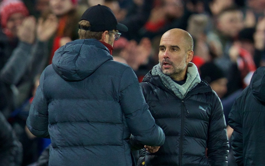 Manchester City's head coach Pep Guardiola (R) shakes hands with Liverpool's manager Jürgen Klopp after the FA Premier League match between Liverpool FC and Manchester City FC at Anfield